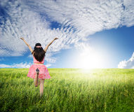 Happy woman jump in green grass field ans bule sky. Beautiful woman jump in green grass field and blue sky Stock Images