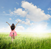 Happy woman jump in green grass field and bule sky Royalty Free Stock Photos