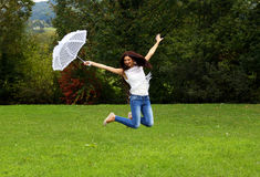 Happy woman jump Stock Photos