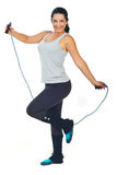 Happy woman with jump rope Royalty Free Stock Photography