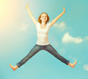 Happy woman jump in the sky Stock Image