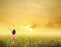 Happy woman jump in sunflower fields and sunset Royalty Free Stock Photos