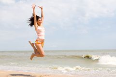 Happy woman is jumping royalty free stock image