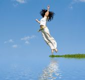Happy woman is jumping Stock Image