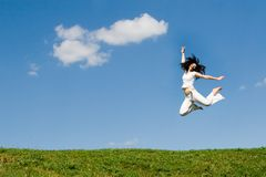 Happy woman is jumping Royalty Free Stock Photos