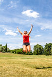 Happy woman jumping for achievement and success Royalty Free Stock Photography