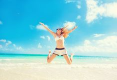 Happy Woman Jumping In The Air having fun On Tropical Beach Royalty Free Stock Photo