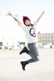 Happy woman jumping. Attractive young woman outdoors, smiling Royalty Free Stock Photography