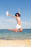 Happy woman jumping in the beach Stock Photo