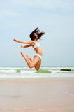 Happy woman jumping on the beach Royalty Free Stock Photography