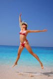 Happy Woman jumping on the beach Stock Photo