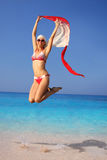 Happy Woman jumping on the beach Stock Photography