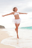 Happy Woman jumping on beach royalty free stock images