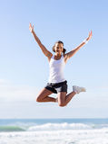 Happy woman jumping Stock Photos