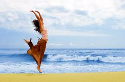 Happy woman is jumping in the beach Royalty Free Stock Photography