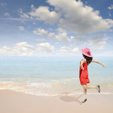 Happy Woman jumping on the beach and clouds  sky Royalty Free Stock Photo