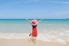 Happy Woman jumping on the beach and clouds  sky Stock Image