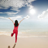 Happy Woman jumping on the beach and clouds  sky Stock Photography