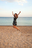 Happy woman jumping on beach. Summer holidays. Stock Photo
