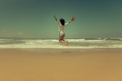 Happy woman jumping at the beach Royalty Free Stock Photography
