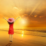 Happy Woman Jumping on Beach Sunset. Stock Photography
