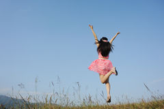 Happy Woman Jumping with blue sky Stock Image