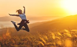 Happy woman jumping and enjoying life  at sunset in mountains Stock Photography
