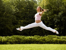 Happy Woman is Jumping. Free Dancer. Freedom concept. Stock Image