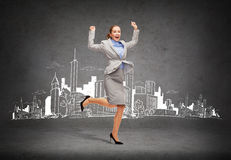 Happy woman jumping with hands up. Business and education concept - young happy woman jumping with hands up Royalty Free Stock Photos