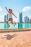 Happy woman jumping on holidays in Abu Dhabi Royalty Free Stock Image