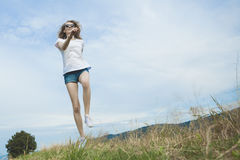 Happy woman jumping on meadow. Stock Photos