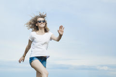 Happy woman jumping on meadow. Stock Photography