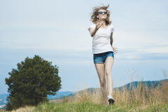 Happy woman jumping on meadow. Royalty Free Stock Photo