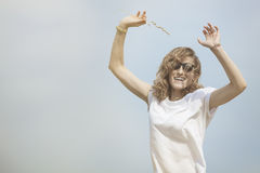 Happy woman jumping on meadow. Royalty Free Stock Photography