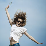 Happy woman jumping on meadow. Stock Images
