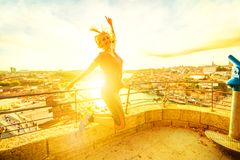 Woman jumping at Oporto royalty free stock photography