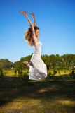 Happy woman jumping outdoor royalty free stock images