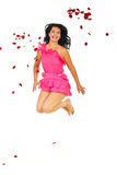 Happy woman jumping through petals Stock Photo