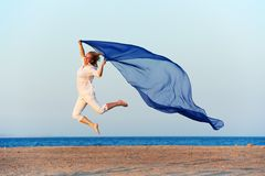 Happy woman jumping on sea beach Royalty Free Stock Photography