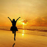 Happy Woman Jumping in Sea Sunset Royalty Free Stock Images