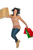 Happy woman jumping with shopping bags Royalty Free Stock Photo