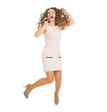 Happy woman jumping and singing with microphone Royalty Free Stock Photography