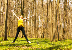 Happy woman jumping in spring nature. Copy space Stock Photos