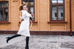 Happy woman jumping in the street Royalty Free Stock Photo