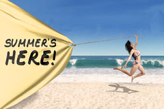 Happy woman jumping with a summertime banner Stock Photo