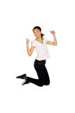 Happy woman jumping with thumbs up. Stock Photography