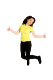 Happy woman jumping with thumbs up. Stock Image