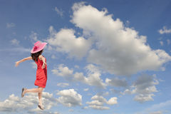 Happy woman jumping to blue clound sky Stock Images