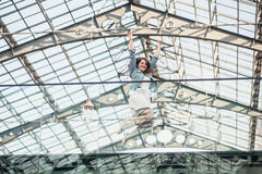 Happy woman jumping up high at airport Royalty Free Stock Image