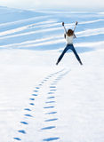 Happy woman jumping at winter mountains Stock Photography